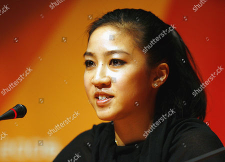 United States figure skater Michelle Kwan speaks at a news conference at the 2006 Turin Winter Olympic Games in Turin, Itlaly . Kwan dropped out of the Turin Games on Sunday morning because of a groin injury, bringing her decade-long quest for Olympic gold to a humbling end