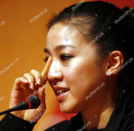 United States figure skater Michelle Kwan speaks at a news conference at the 2006 Turin Winter Olympic Games in Turin, Italy . Kwan dropped out of the Turin Games on Sunday morning because of a groin injury, bringing her decade-long quest for Olympic gold to a humbling end