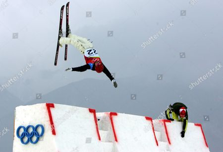 Stock Photo of Enver Ablaev of Ukraine jumps off the ramp as Swiss coach Michel Roth stands by, ahead of Men's Aerials final at the Turin 2006 Winter Olympic Games at Sauze d'Oulx, Italy