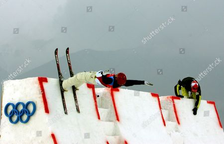 Stock Picture of Enver Ablaev of Ukraine is about to jump off the ramp as Swiss coach Michel Roth stands by, ahead of Men's Aerials final at the Turin 2006 Winter Olympic Games at Sauze d'Oulx, Italy