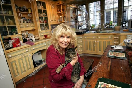 Carla Lane at her home, Sussex. Here with her cat Daniel, who is 28 years old.