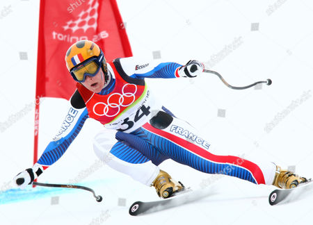 Carole Montillet-Carles speeds past a gate during the Women's Downhill at the Turin 2006 Winter Olympic Games in San Sicario Fraiteve, Italy