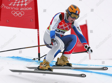 Carole Montillet-Carles of France speeds past a gate during the Women's Downhill at the Turin 2006 Winter Olympic Games in San Sicario Fraiteve, Italy
