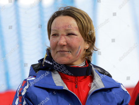 Stock Image of Carole Montillet-Carles of France stands near the finish area after the Women's Downhill at the Turin 2006 Winter Olympic Games in San Sicario Fraiteve, Italy, . Montillet-Carles, who finished in 28th place, was injured in a crash during training for the downhill on Monday