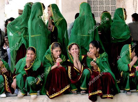 Stock Picture of AFGHAN ORPHANS Afghan orphans wearing traditional Afghan clothes wait to catch a glimpse of French Woman's Affairs Minister Nicole Ameline at the Tayaimaskan Orphanage in Kabul . France is one of the biggest aid donors to Afghanistan