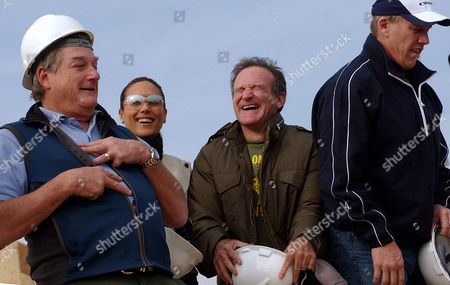 DOLPHINS From left to right, comedian Blake Clark, U.S. model Leeann Tweeden, comedian Robin Williams, and former Denver Broncos great John Elway, laugh as they make a joke at the main U.S. base at Bagram, north of Kabul, Afghanistan,. U.S. forces serving at Bagram air base got a little early Christmas cheer Thursday _ a surprise visit from them and the military's joint chiefs of staff