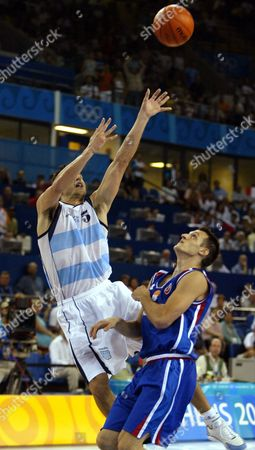 GINOBILI OSTOJIC Argentina's Emanuel David Ginobili, left, shoots the game-winning shot over Serbia and Montenegro's Djuro Ostojic as time expired in a preliminary round game at the Helliniko Indoor Arena in Helliniko, Greece during the 2004 Olympics Games, . Argentina defeated Serbia and Montenegro 83-82