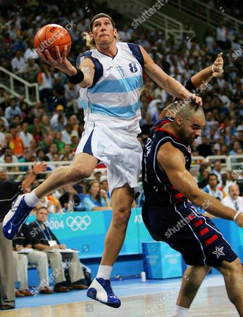 HERRMANN BOOZER Argentina's Walter Herrmann (8) goes over the head of the USA's Carlos Boozer to make a shot in the second period of their game at the Olympic Indoor Hall during the 2004 Olympics in Athens, Greece on