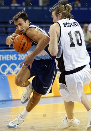 GINOBILI BOUCHER Argentina's Emanuel David Ginobili, left, loses control of the ball as he drives on New Zealand's Dillon Boucher in the first half of a preliminary round game at the Helliniko Indoor Arena in Athens during the 2004 Olympics Games