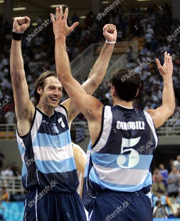 Argentina's Emanuel David Ginobili, right, celebrates with Fabricio Oberto following a 69-64 win over Greece in a quarterfinal game at the Indoor Arena in Athens during the 2004 Olympics Games