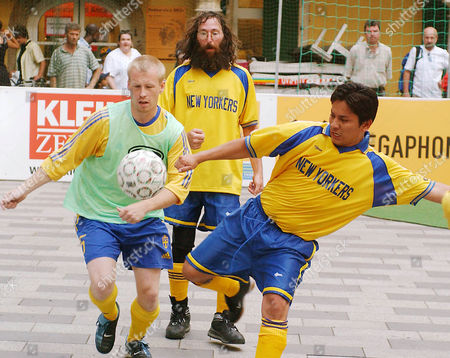 Stock Picture of PANKIN RIVERA OLSSON U.S. homeless street soccer player Erik Rivera, right, battles for the ball with Sweden's Hakan Olsson, while U.S. player Harris Pankin, center, looks, during a Homeless Soccer World Cup match, in Graz, Austria
