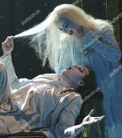 """Stock Image of MERBETH SCHADE Michael Schade as Leukippos and Ricarda Merbeth as Daphne, top, perform during a dress rehearsal for Richard Srauss' opera """"Daphne,"""", at Vienna's state opera. The opera's premiere is on Sunday, June 13, 2004, and is directed by Nicolas Joel and conducted by Semyon Bychkov"""