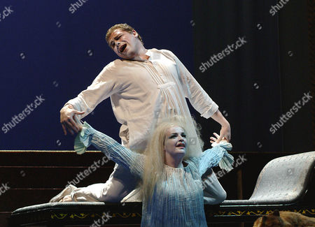 """Stock Picture of MERBETH SCHADE Michael Schade as Leukippos, top, and Ricarda Merbeth as Daphne, perform during a dress rehearsal for Richard Strauss' opera """"Daphne"""",, at Vienna's state opera. The opera premiere is on Sunday, June 13, 2004, and is directed by Nicolas Joel and conducted by Semyon Bychkov"""