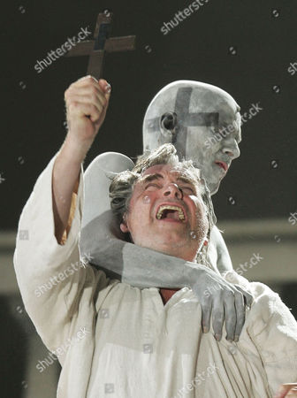 """SIMONISCHEK HARZER Peter Simonischek as Everyone, front, and Jens Harzer as Death perform during a dress rehearsal for the classical theatre work """"Everyone"""" by Hugo von Hofmannsthal in Salzburg, Austria on . Premiere of the mystical play is on Saturday, July 24th., as part of the Salzburg Festival"""