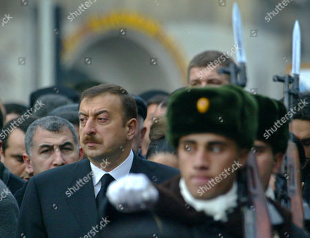 Azerbaijan President Ilkham Aliev, left, follows a coffin with the body of his father, former President Geidar Aliev, unseen, during a funeral ceremony in Baku, Azerbaijan, . The 80-year-old leader's death Friday at the Cleveland Clinic in Ohio puts the focus now on his son and successor amid questions whether he has the stature to carry on his father's legacy in this former Soviet republic of 8 million