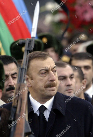 Azerbaijan President Ilkham Aliev follows the coffin with the body of his father, former President Geidar Aliev, during a funeral ceremony in Baku, Azerbaijan, . The 80-year-old leader's death Friday at the Cleveland Clinic in Ohio puts the focus now on his son and successor amid questions whether he has the stature to carry on his father's legacy in this former Soviet republic of 8 million