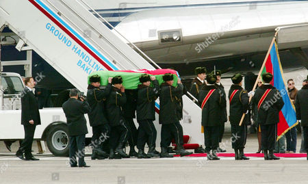 Officers carry the coffin with the body of former Azerbaijan President Geidar Aliev as his son, President Ilkham Aliev, left, follows them in an airport in Baku, Azerbaijan, Sunday, Dec.14, 2003. The 80-year-old Aliev died Friday in a clinic in Ohio and his body was delivered to Azerbaijan Sunday