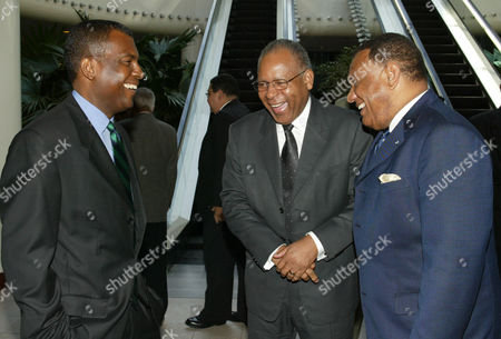 FROM LEFT: MITCHELL, MANNING AND CHRISTIE STAND IN GROUP SMILING Prime Minister of Trinidad and Tobago Patrick Manning, center, enjoys a light moment with Bahamian Minister of Foreign Affairs Fred Mitchell, left, and Bahamian Prime Minister Perry Christie during a lunch break from talks between CARICOM leaders and members of the Haitian opposition at the Wyndham Crystal Palace Resort in Nassau, Bahamas. CARICOM leaders continued a second day of meetings with members of the Haitian opposition to try to resolve the current unrest in Haiti