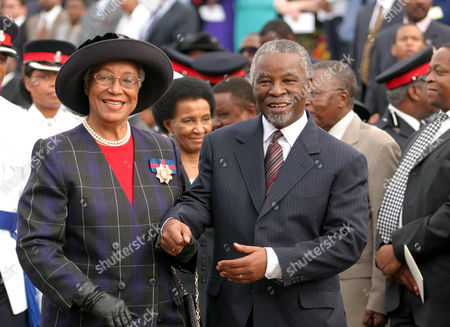 MBEKI DUMONT South African President Thabo Mbeki and Governor General of the Bahamas Dame Ivy Dumont holds hands as they begin an impromtu walkabout waving to spectators at the Beat the Retreat ceremony held by the Royal Bahamas Police Force Band in Rawson Square, Nassau, Bahamas . Mbeki arrived in the capital for a four day visit where he will attend a State Reception at the Government House and a meeting with Prime Minister Perry Christie and his Cabinet and will have the opportunity to view the Junkanoo street festival before leaving for Haiti on Jan. 1, 2004