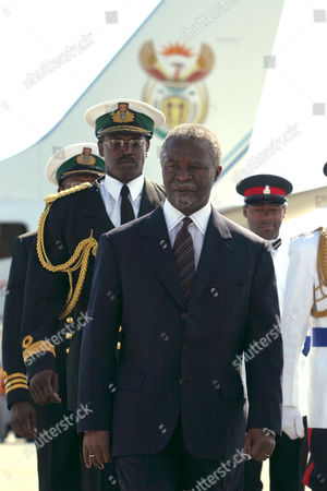 HONOR South African President Thabo Mbeki inspects a guard of honor, with members of the Royal Bahamas Police Force and the Defence Force, at a welcoming ceremony at Nassau International Airport in Nassau, Bahamas. Mbeki, accompanied by his wife Madame Zanele Mbeki, arrived in the capital for a four day visit where he will attend a State Reception at Government House and a meeting with Prime Minister Perry Christie and his Cabinet and will have the opportunity to view the Junkanoo street festival before leaving for Haiti on Jan. 1, 2004