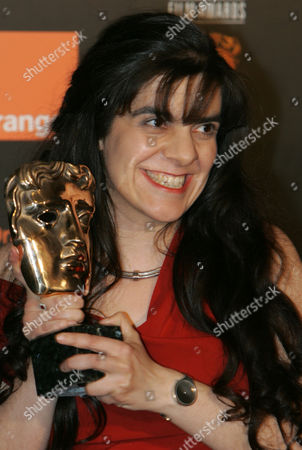 Tanya Seghatchian holds the Alexander Korda award for outstanding British Film of the Year for her film My Summer of Love at the British Academy Film Awards in London's Leicester Square