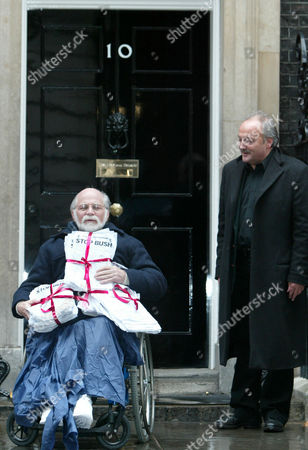 Vietnam veteran Ron Kovic, who wrote 'Born on the 4th of July' about his experiences, outside the Prime Minister's residence, 10 Downing Street in London, . Kovic, along with other anti-war campaigners including George Galloway M.P., right, were handing in a petition calling on the coalition forces to leave Iraq
