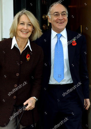 """Britain's new Conservative Party leader Michael Howard leaves his London home with his wife Sandra, . Howard will succeed Ian Duncan Smith as leader of the main opposition party after Duncan Smith failed a confidence vote last week. Howard, 62, who stood unopposed to succeed Iain Duncan Smith at the helm of the once-mighty party, promised to """"lead from the centre'' to challenge Prime Minister Tony Blair's government"""