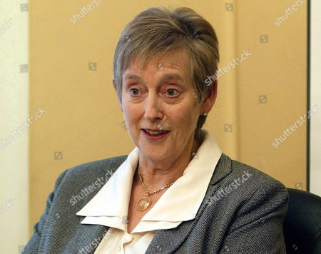 """The former head of the British Intelligence service Stella Rimington poses in her office in London. British lawmakers say the country's intelligence agencies, which inspired James Bond, are not doing enough to promote real-life Jane Bonds. A report on women in the intelligence services says female staff are being held back by a layer of middle managers, dubbed """"the permafrost,"""" who have """"a very traditional male mentality and outlook."""" The report published by Parliament's Intelligence and Security Committee said that women make up 37 percent of the workforce at domestic spy service MI5, overseas intelligence agency MI6 and electronic eavesdropping center GCHQ"""