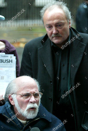 Vietnam veteran Ron Kovic, below, who wrote 'Born on the 4th of July' about his experiences in Vietnam, outside 10 Downing Street in London, . Kovic, along with other anti-war campaigners including, George Galloway M.P., background, were handing in a petition calling for the coalition forces to leave Iraq