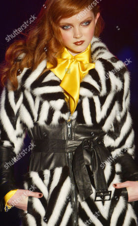 A model wears an outfit by British designer Julian Macdonald during his show at London Fashion Week in London, . The designers are showing their Autumn/Winter 2004/2005 collections