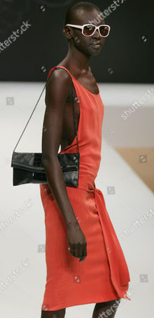 Model Alek Wek wears a design by Camilla Staerk, a London based Danish designer, during her catwalk show at London Fashion Week in London . Staerk is showing her Spring/Summer 2005 collection