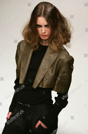 A model wears a cropped leather jacket by Danish designer Camilla Staerk at London Fashion Week . The designers are showing their autumn/winter 2005/06 collections