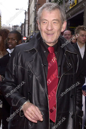"""British actor Sir Ian McKellan poses on his arrival at the Prince Edward Theater in London for the fifth anniversary of the musical """"Mamma Mia!"""" in London's West End"""