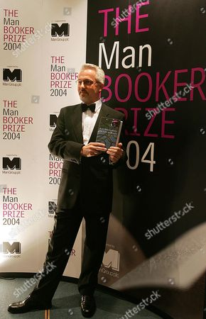 "Alan Hollinghurst, winner of the 2004 Man Booker Prize for fiction poses for the cameras after the awards in London late . Hollinghurst's book entitled ""The Line of Beauty"" won the prize of 50,000 pound (US$90,000, 72,000 euro) from a shortlist of six"