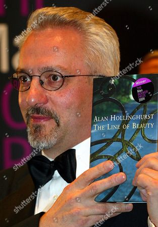 "Alan Hollinghurst, winner of the 2004 Man Booker prize for fiction poses for the cameras after the awards in London, . Hollinghurst's book entitled ""The Line of Beauty"" won the prize of 50,000 pound (US$90,000, 72,000 euro) from a shortlist of six"