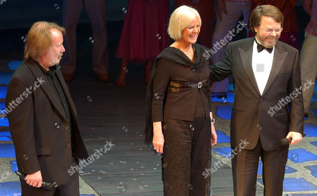 """Members of the ABBA rock group, Benny Anderson, left, Anni-Frid Lyngstad and Bjorn Ulvaeus, right, gather on stage at the Prince Edward Theater in London where they came together for the fifth year anniversary of the musical """"Mamma Mia!"""" in London's West End, . A fourth member of the group, Agnetha Faltskog, did not attend"""