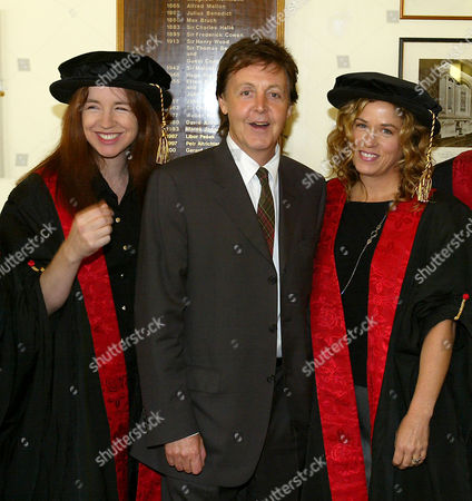 BANGLES Sir Paul McCartney poses with two members of The Bangles, Michael Steele, left, and Vicki Peterson, who where made companions of the Liverpool Institute for Performing Arts during a ceremony, at the Liverpool Philharmonic Hall. McCartney presented degree certificates to students