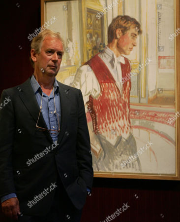 Artist John Wonnacott stands by an oil sketch he painted of Britain' Prince William in preparation for a painting of the British Royal family, at a gallery in central London . The final group painting is in the National Gallery in London who commissioned Wonnacott for the group painting. The sketch has been put up for sale and is expected to fetch an estimated price of 100,000 pounds, (184,000 US