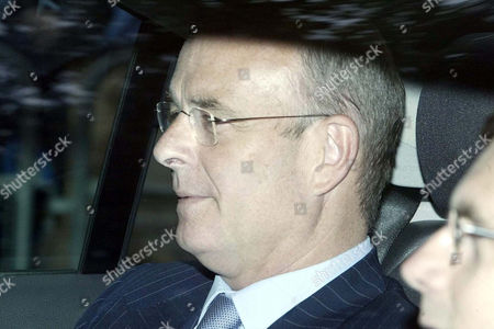 John Scarlett, Chairman of Britain's Joint Intelligence Committee arrives at the Royal Courts of Justice in London, . Scarlett testified before a judicial inquiry investigating the suicide of weapons adviser David Kelly, a top British scientist who took part in the drafting of the dossier on Saddam Hussein's alleged weapons of mass destruction