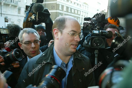 BBC TV reporter Andrew Gilligan, who interviewed the late weapons advisor David Kelly, arrives at the BBC headquarters at Portland Place in London, . Lord Hutton cleared Prime Minister Tony Blair's government Wednesday of any direct involvement in the suicide of a government expert on Iraqi weapons but criticized the BBC for its reporting in the scandal that shook the British leadership