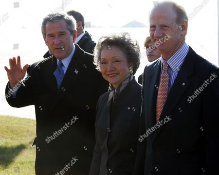 BUSH CLARKSON RALSTON President George W. Bush, left, walks with Governor General Adrienne Clarkson, center, and her husband John Ralston upon his arrival in Ottawa, Canada