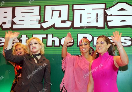 Stock Photo of TOSUN Singers, from left, Nelly McKay, Cyndi Lauper, Alicia Keys and Sylvia Tosun wave during a meet-the-press event in Beijing . The performers are to stage a concert on the Great Wall of China Saturday to support a Chinese children's charity