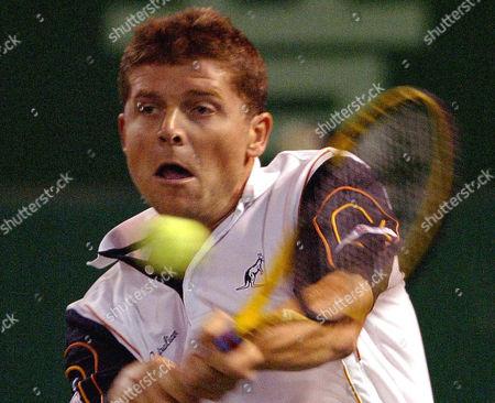 NOVAK Czech player Jiri Novak returns the ball against Jan-Michael Gambill, of the United States during a quarterfinal match of the Heineken Open tennis tournament in Shanghai, China. Second-seeded Novak beat Gambill 6-3, 6-3