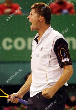 NOVAK Czech player Jiri Novak reacts during a quarterfinal match of the Heineken Open tennis tournament against Jan-Michael Gambill, of the United States in Shanghai, China. Novak won over Gambill 6-3, 6-3