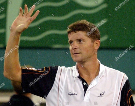 NOVAK Czech player Jiri Novak waves to audience after his hictory over Jan-Michael Gambill, of the United States in their quarterfinal match of the Heineken Open tennis tournament in Shanghai, China.Second-seeded Novak won over Gambill 6-3, 6-3