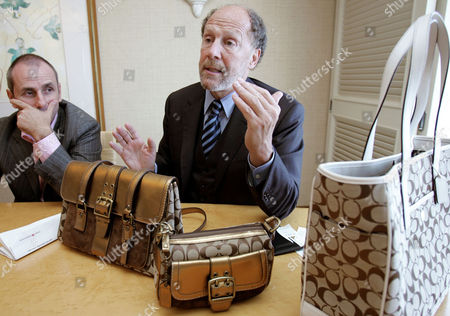 """FRANKFORT BICKELY Coach Chief Executive Lew Frankfort, accomanied by Ian Bickely, president of Coach Japan, speaks with the New York-based company's fall collection during an interview with The Associated Press in his recent visit to Tokyo . Coach is now the No. 2 import-bag and accessory brand in Japan in sales just trailing Louis Vuitton of France, an obsessive favorite here for decades. """"We have a unique brand proposition. We are an accessible luxury accessories brand in which we offer extremely well-made products that are relevant to Japanese consumers' lifestyles at very attractive prices,"""" Frankfort says"""