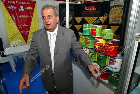 "PEDRO ALVAREZ Cuban Pedro Alvarez President of Cuban ""Alimport"" company is seen at a American food stand from Florida one day before the opening of Havana's international fair. Florida fruit juices and North Carolina turkey are among products American companies are showing off in Cuba this week as U.S. agriculture producers press to sell more products to the communist island. Grouped at the International Fair of Havana, opening Sunday afternoon, the 71 American firms from 18 states and Puerto Rico hope their displays will persuade Cuban officials to buy more under an exception in a 42-year U.S. trade embargo"