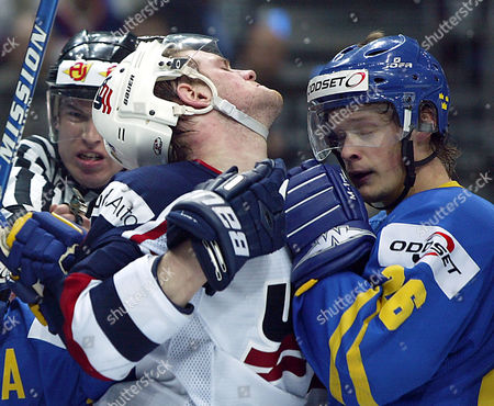 HALL, PALSSON Sweden's Samuel Palsson, right, and Adam Hall, from the USA, battle during a semifinal between Sweden and USA at at the 68th Ice Hockey World Championships in Prague, Czech Republic