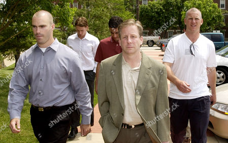 JACKMAN WOODCOCK TKACHUK Members of the St. Louis Blues hockey organization, player Barret Jackman, left, marketing director Jim Woodcock, center, and player Keith Tkachuk, right, arrive at the the federal courthouse in East St. Louis, Ill., for Michael Danton's detention hearing . U.S. Magistrate Clifford Proud ordered Danton to remain in jail, with his trial scheduled to begin July, 20, 2004