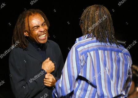 Brazilian jazz legends Gilberto Gil, left, and Milton Nascimento laugh with one another before Nascimento's performance in Copenhagen, Denmark at the Copenhagen Jazz Festival